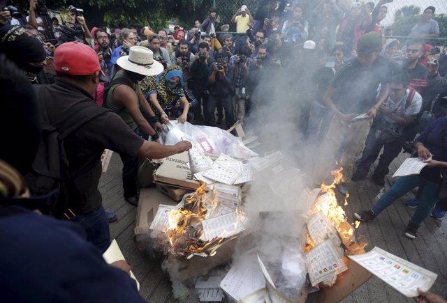 Activists burn ballots and electoral materials in Tixtla, Guerrero