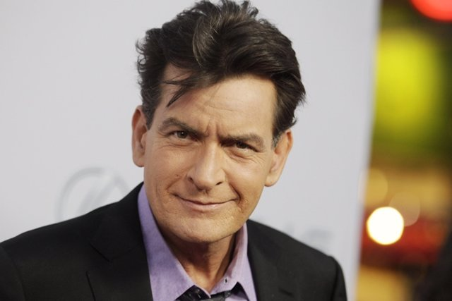 "Cast member Charlie Sheen poses at the premiere of his new film ""Scary Movie 5"""