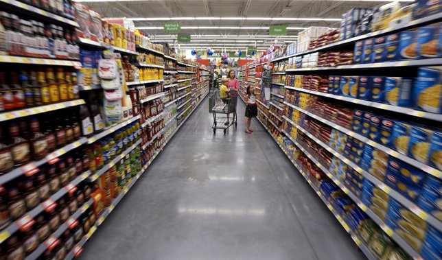 A family shops at the Wal-Mart Neighborhood Market in Bentonville