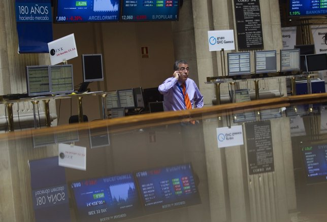 A trader talks on the phone at Madrid's Bourse