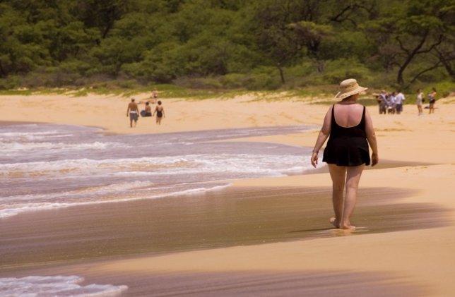 Obesidad, mujer, playa