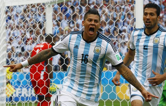 Argentina's Rojo celebrates his goal against Nigeria during their 2014 World Cup