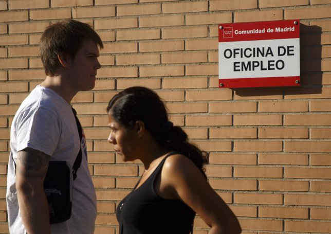 People stand in front of a government-run employment office in Madrid