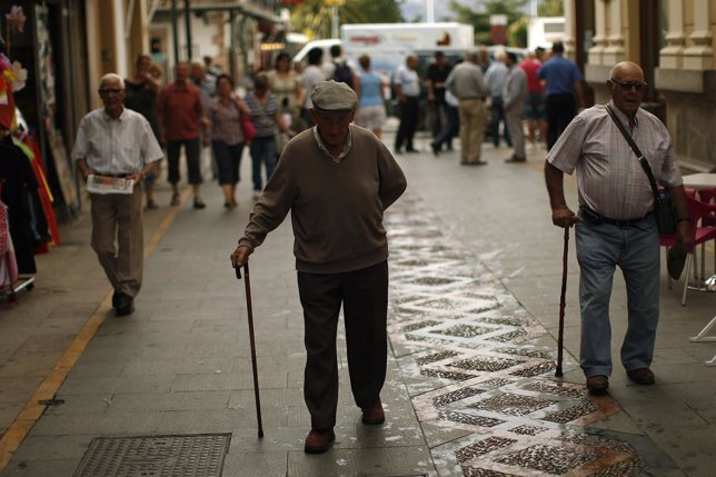 Pensioners walk along La Bola street during the International Day of Older Perso
