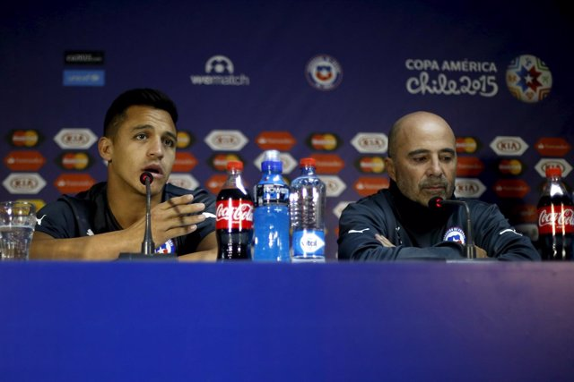 Chile's national team soccer coach Sampaoli and Sanchez deliver a news conferenc