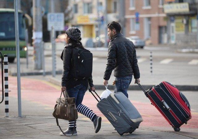 Viajeros con maletas