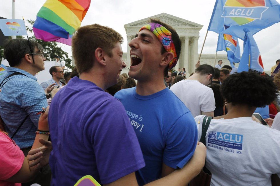 Gay rights supporters celebrate outside the U.S. Supreme Court building in Washi