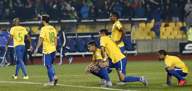 Brazil's players react after losing their penalty shootout to Paraguay in their