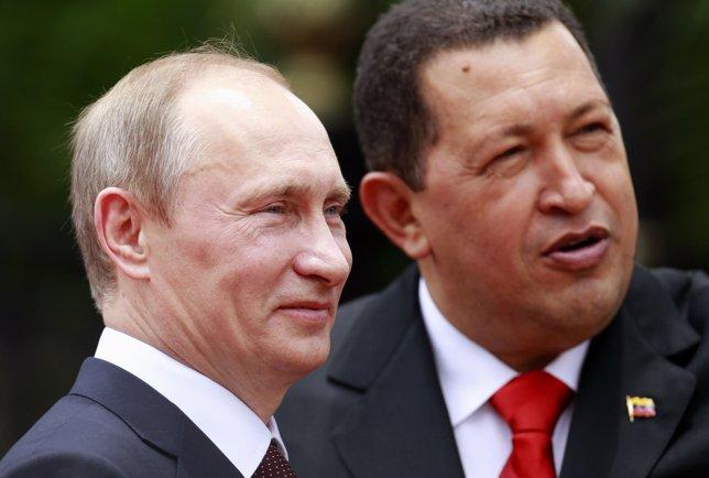 Venezuela's President Chavez welcomes Russia's PM Putin in Caracas