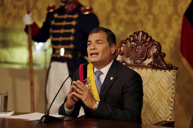 Ecuadorean President Rafael Correa gestures as he addresses a television broadca