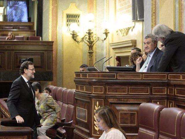 Mariano Rajoy en la tribuna del Congeso ante Jesús Posada