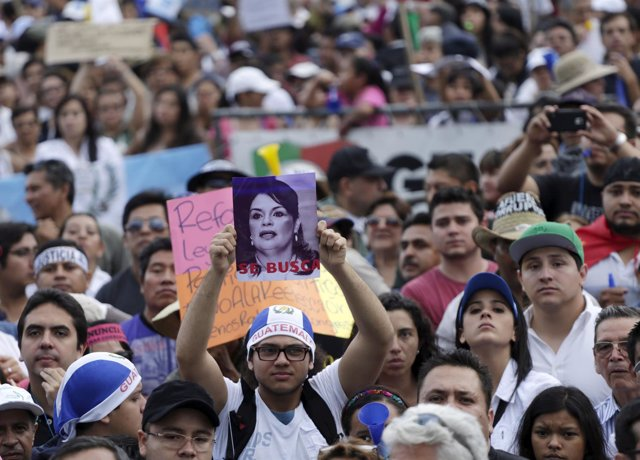 A protester holds picture