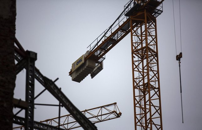The logo of Spanish builder OHL on a crane at a construction site in Madrid