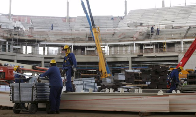 Workers are pictured at the basketball venue at the Rio 2016 Olympic Park in Rio