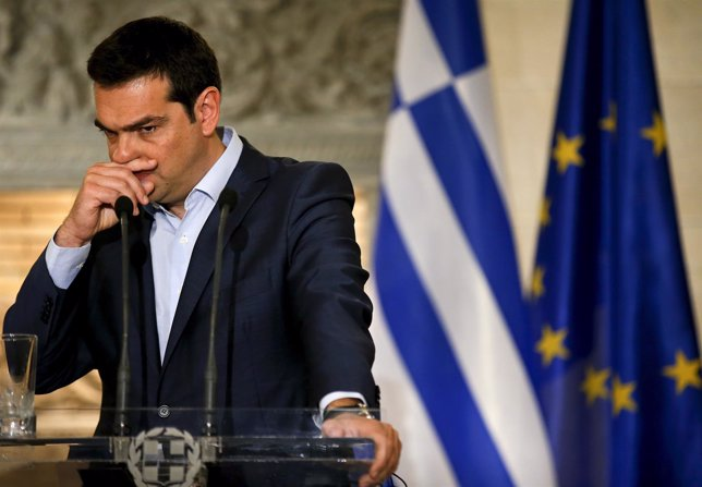Greek PM Tsipras gestures during a news conference in Athens