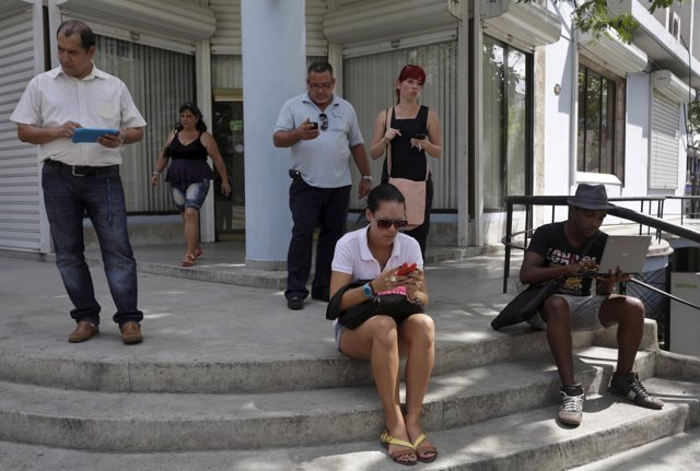 Cubans use the internet via public Wi-Fi in Havana