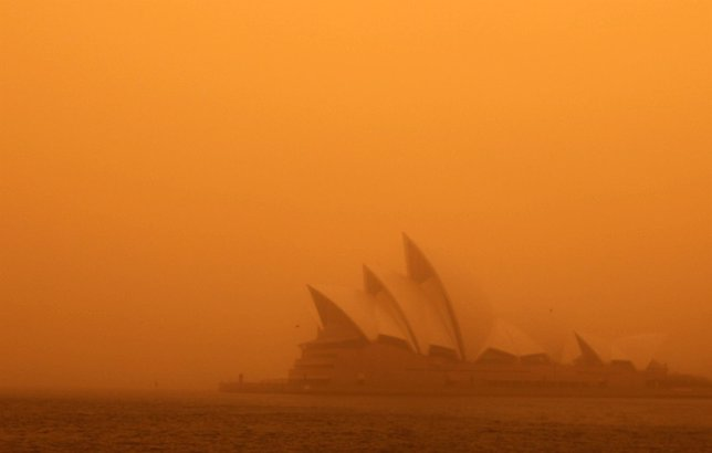 A dust storm blankets Sydney's iconic Opera House at sunrise