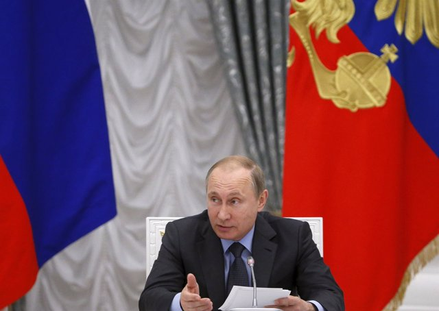 Russian President Putin speaks during meeting of presidential council on science