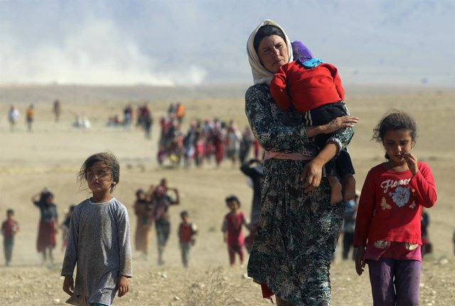 File photo of displaced people from the minority Yazidi sect, fleeing violence f
