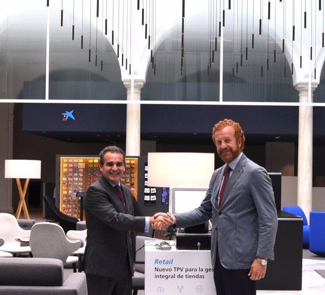 Rafael Herrador, de CaixaBank, y Manuel Otero, de los hoteleros de Sevilla
