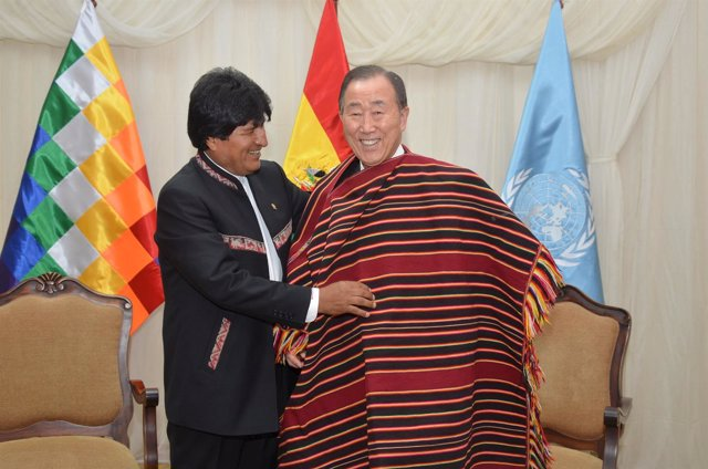 "Handout photo of Bolivia's President Morales arranging a Tarabuco's ""poncho"" to"