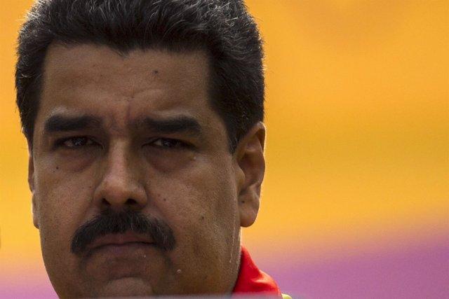 Venezuela's President Nicolas Maduro looks on during a rally outside Miraflores