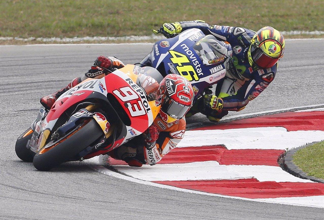 Honda MotoGP rider Marquez of Spain and Yamaha MotoGP rider Rossi of Italy ride