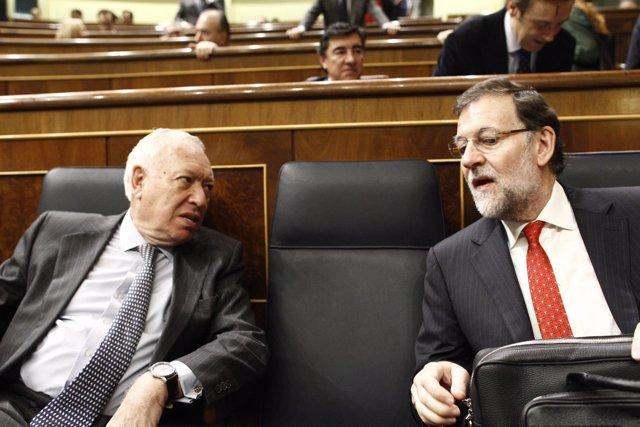 José Manuel García Margallo y Mariano Rajoy.