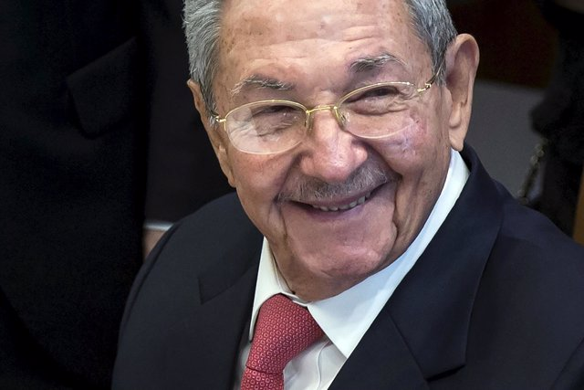 Cuba's President Raul Castro signs a guest book in the United Nations Secretary