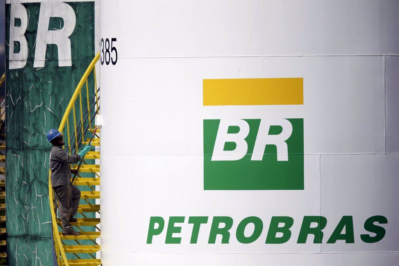 A worker paints a tank of Brazil's state-run Petrobras oil company in Brasilia