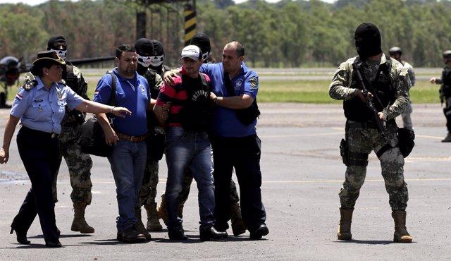 Former Paraguayan Mayor Vilmar Acosta is being escorted by soldiers and members