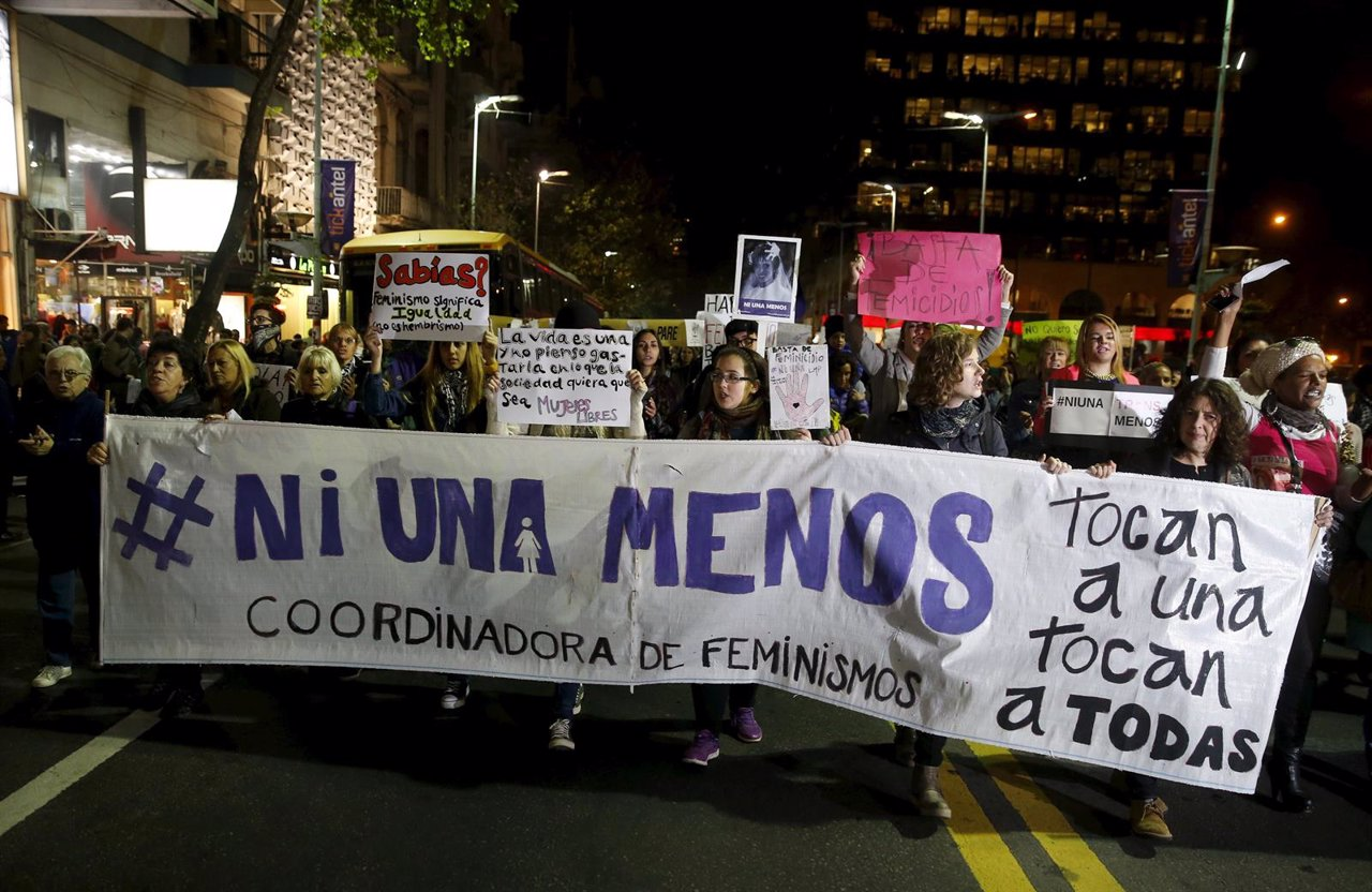 People participate in a demonstration against gender violence and femicide in Mo