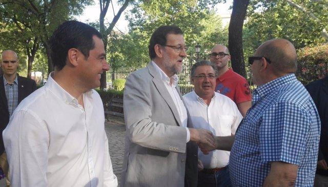 Juanma Moreno, Rajoy y Zoido en Sevilla.