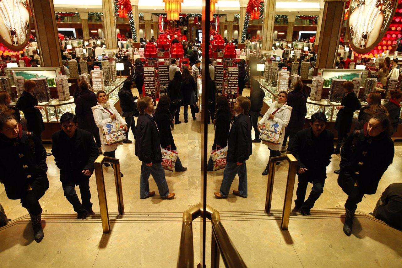 Customers shop at Macy's department store in New York