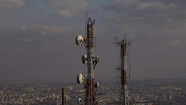 Man works on a tower in Sao Paulo