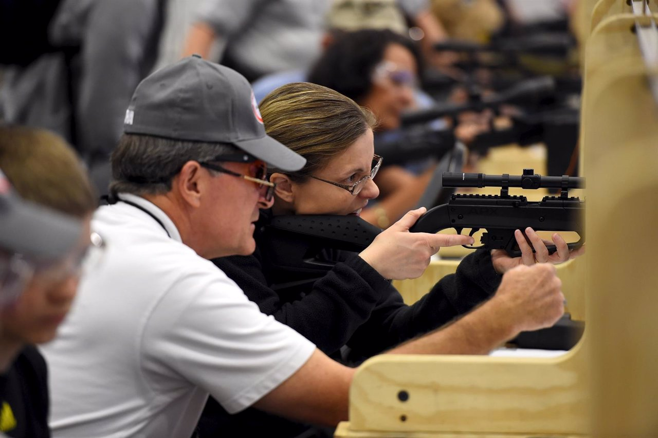 Attendees visit the air gun range during the NRA's annual meeting in Nashville