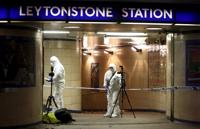 Emergency responders investigate a crime scene at Leytonstone underground statio