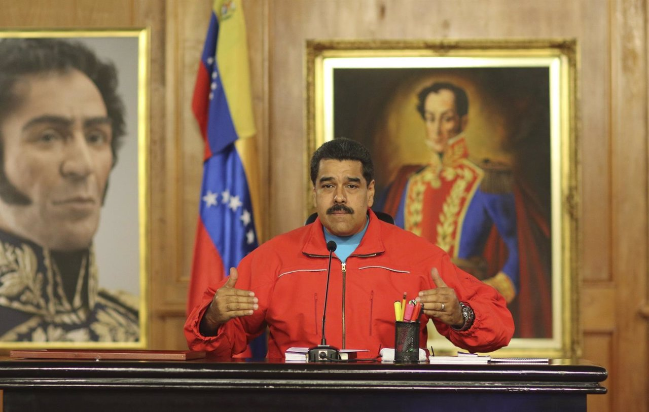 Venezuela's President Nicolas Maduro talks to the media during a news conference