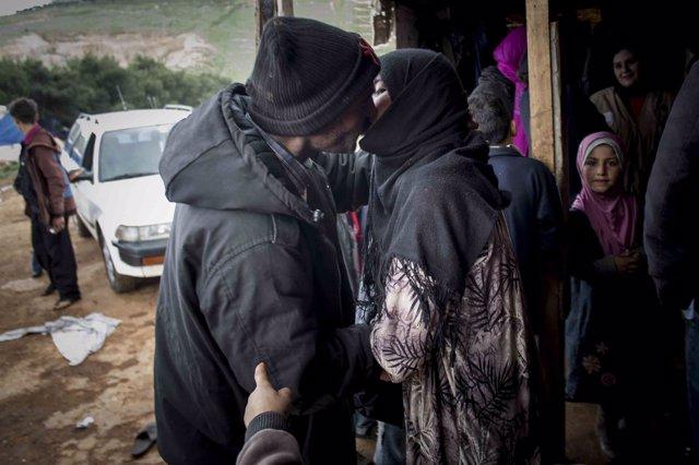 Refugiados, beso
