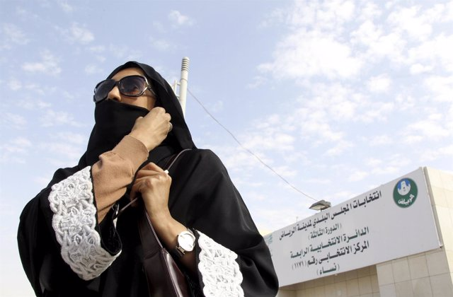 Saudi woman leaves a polling station after casting her vote during municipal ele