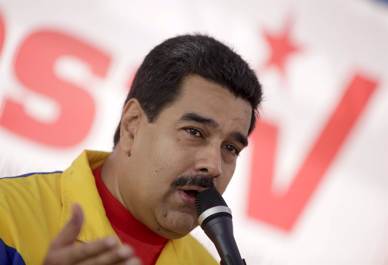 Venezuela's President Nicolas Maduro speaks in a news conference after voting in