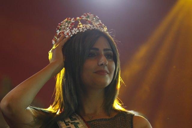 Miss Iraq Shaima Qassem reacts during the Miss Iraq Pageant in Baghdad