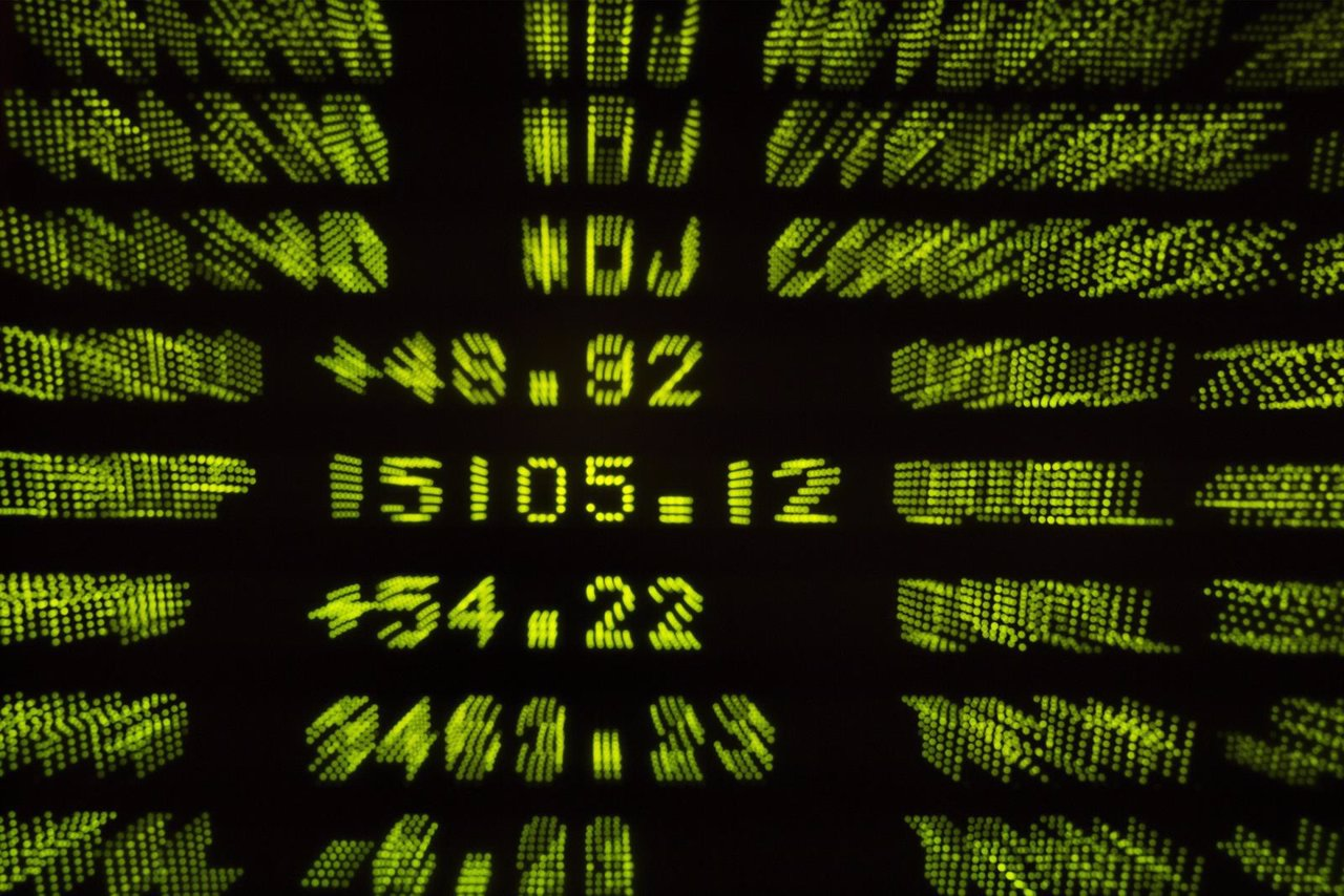 A screen displays the final tally for the Dow Jones industrial average at the Ne