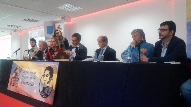 Representantes de los partidos firmando el manifiesto por Venezuela