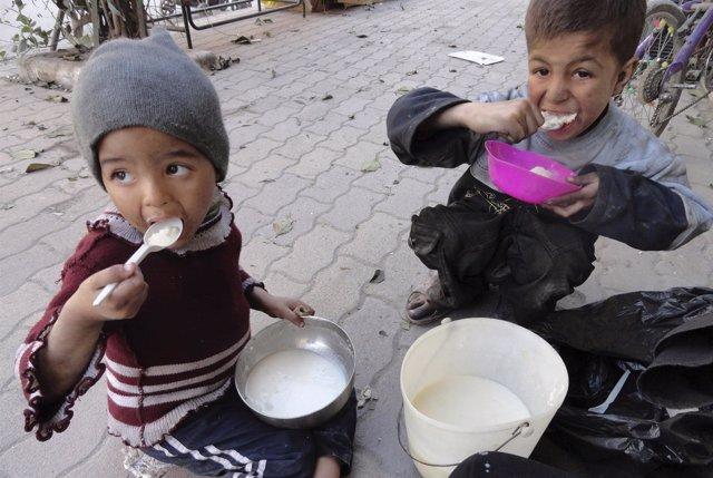 Niños palestinos refugiados en Siria