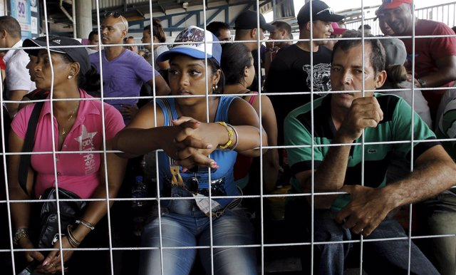 Cubans migrants await to receive humanitarian visas at a border post with Panama