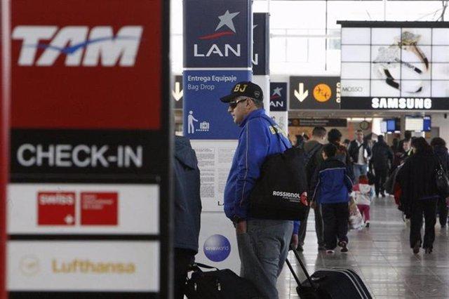 Los puntos de embarque de la aerolínea chilena LAN y la brasileña TAM, ahora fus