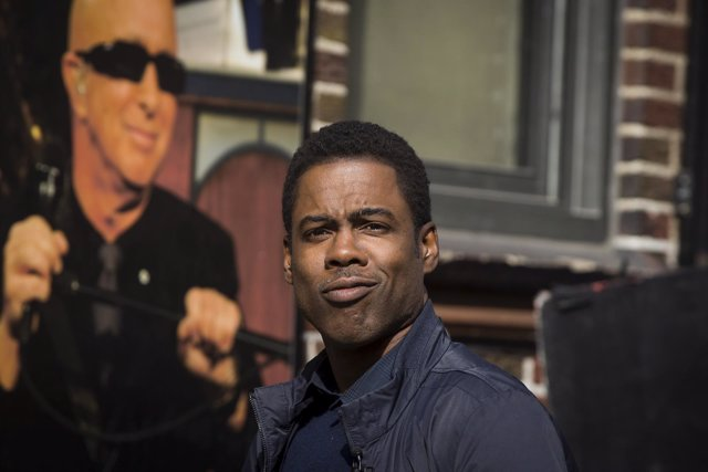 Comedian Chris Rock arrives at the Ed Sullivan Theater in Manhattan to take part