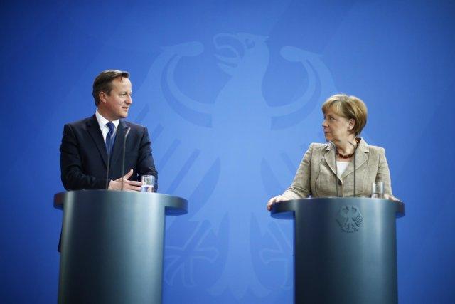 David Cameron y Angela Merkel durante una rueda de prensa en Berlín.