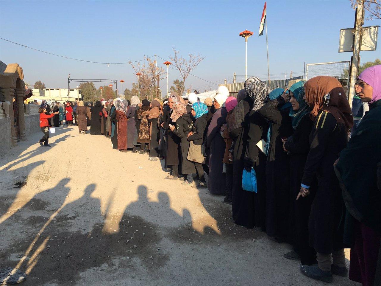 Reparto de ayuda del CICR en Muadamiya, en Siria